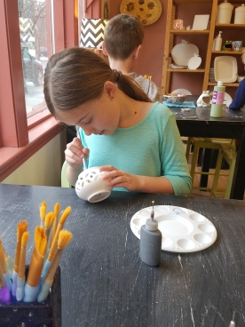 Kiera paints pottery